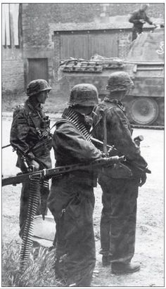 Waffen SS Grenadiers with an MG 42 near a Panther from I./SS-Panzer Regiment 12, 25 June 1944.