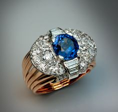 A Vintage Art Deco Ceylon Sapphire and Diamond Ring  circa 1930  The platinum and 18K gold ring is centered with an oval unheated 5.06 ct Ceylon sapphire