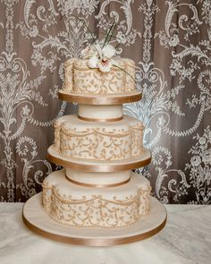 3 tier petal shaped cake with piped design and sugar orchid.