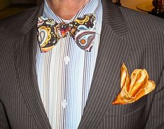 Hugo Boss brown pin-stripe suit, custom-made bow-tie.. I would look like a Ravishing Debonaire in this ! Don't yah think.. Right !!