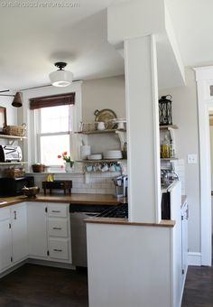 Loving this small kitchen redo! Love this column thing, since we have a similar situation in our kitchen!!