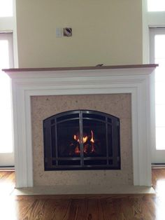 Mendota Direct Vent Gas Fireplaces, Custom Wall, Custom Mantle all by RFS Love it! DESIRE: Bentley with vintage iron or black Direct Vent Gas Fireplace, Fireplace Inserts, Fireplace Stores, Gas Fireplaces, Vintage Iron, Mantles, Fireplace Surrounds, Custom Cabinetry
