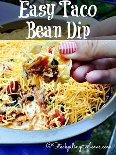 This Easy Taco Bean Dip recipe is the PERFECT appetizer for any party! Great for watching football games.