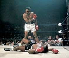 Muhammad Ali stands over Sonny Liston after knocking him out in the first round of their 1965 fight.