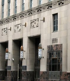Cincinnati Bell Building (1931) - twelve-story building designed in the Art Deco style by Harry Hake. Each floor was given 12' to facilitate phone equipment. Above the second story runs a decorative border alternating French telephones and headsets. A runner, Bell's telephone and flags for signaling also continue the communication theme with reliefs. The lobby is finished in marble with gold and silver decorative pieces.