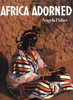 """Africa Adorned - by Angela Fisher -  Harry N. Abrams; First edition  1984 - 304 pp - - - FRENCH version is titled : """"Fastueuse Afrique"""" - - - a MUST !!!! I have this its my favorite book."""
