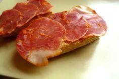 "TOASTS OF ""LOMO EMBUCHADO"".   Lomo Embuchado from Spain: Cured pork tenderloin from serrano pork or from acorn-fed Ibérico pigs, traditionally prepared by small producers."