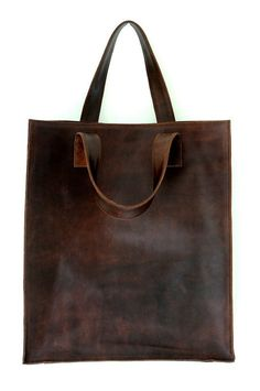 I really like the color of this leather bag and how it loos very plain and unconstructed. This is a bag I would grab when I am runing out the door.