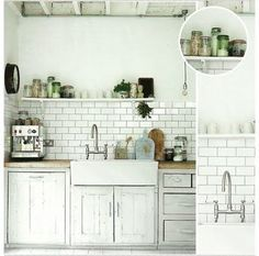 subway tiled kitchen, open shelves. cutting board top