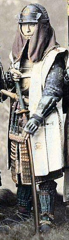 Samurai wearing hachi-gane (forehead protector) and jinbaori.