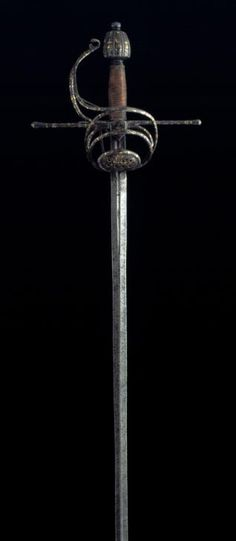 "Swept Hilt Sword with ""Damasquinado"" Technique, 16th Century, Steel, Wood, Gold, Iron, 123.5 cm, Inventory Number 203, Museo Lázaro Galdiano, Madrid."