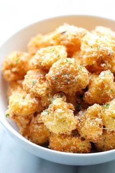 Parmesan Cauliflower Bites by damndelicious: Use the Parmesan Puffs instead of bread crumbs. Crisp, crunchy cauliflower bites that even the pickiest of eaters will love. Perfect as an appetizer or snack Parmesan Cauliflower, Cauliflower Bites, Buffalo Cauliflower, Parmesan Crisps, Cauliflower Recipes Fried, Cauliflower Fritters, Zucchini Fritters, Parmesan Crusted, Vegetable Dishes