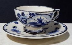 Handpainted Holland Blue Floral Cup & Saucer Set Item: This is a Made in Holland Hand painted Blue Floral Tea Cup & Saucer Set. Cup And Saucer Set, Tea Cup Saucer, Blue Pottery, White Cups, Tea Parties, Tea Sets, Fine Porcelain, Delft, Vintage China