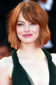 Emma Stone's new bob with blunt ends and side-swept bangs is so fresh and chic. Trying to grow my bangs like this now....