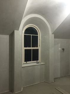 Attic arched windows with splayed reveals and sliding sash window