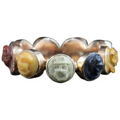 Rare Antique Georgian Cameo Eternity Ring, circa 1800   From a unique collection of vintage engagement rings at https://www.1stdibs.com/jewelry/rings/engagement-rings/