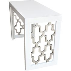 Featuring openwork arabesque designs in a lacquered silver leaf finish, this…
