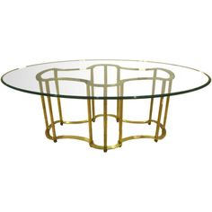 An Oval Top Glass and Brass Dining Table by Mastercraft