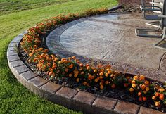 Stamped Concrete Patio with Flower Bed and Edging idea.