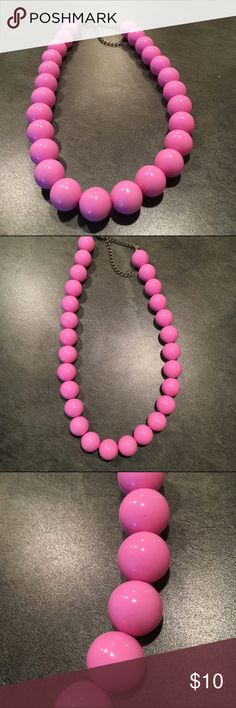 Merona Pink Bead Necklace Super cute twist on the classic Pearl necklace. This Merona Bead necklace has bubblegum pink chunky plastic beads and an adjustable lobster clip/chain closure. One of my all-time favorites. Retro, vintage style. Discounts on bundles! Merona Jewelry Necklaces