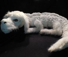 Hang out with your favorite dog-like mythical creature whenever you want by cuddling up with this Neverending Story Falkor plushie. It's skillfuly made using three different types of faux fur and features realistic hand painted eyes.