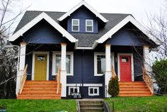 Bright navy exterior of a home in Portland, OR. Photo courtesy of Young House Love. by geneva where E + I will live! Cottage Exterior, House Paint Exterior, Exterior Paint Colors, Exterior House Colors, Exterior Design, Garage Exterior, Dark Blue Houses, Navy Houses, Blue Siding