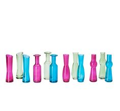 Colored bud vases as accents on the table