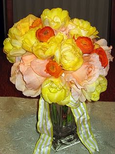 spring bouquet, yellow peony tulips, garden roses and orangeranunculus. couple pictures on website.