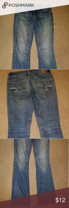 American Eagle jeans Boot cut, in decent condition, has a small hole in the right knee American Eagle Outfitters Pants Boot Cut & Flare
