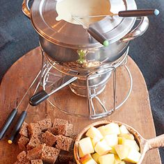 A classic cheese fondue using both Swiss and Gruyere cheese. One of our favorites for a relaxed Sunday afternoon. From @NevrEnoughThyme http://www.lanascooking.com/cheese-fondue