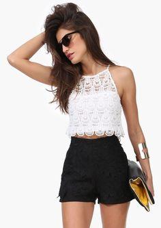 White crop top. Black high waist shorts.