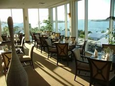 Interior shot of Blu Bar & Grill. Offering a breathtaking panoramic view of the Great Sound, Blu is known for its traditional Sunday brunch and fantastic steaks! Bermuda