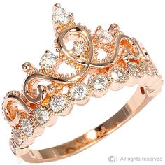 This beautiful sterling silver crown ring / princess ring resembles the woman who wears it. It is covered in 17 cubic zirconias, giving it a