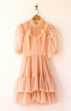 1980s vintage little girls peach pindot dress.. Wanna dress miles up in dresses I use to wear. Lol
