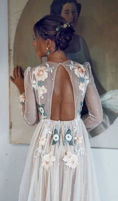 This delicate cut out back panel dress would be beautiful to wear at a marquee rehearsal dinner