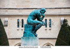 """PARIS, FRANCE - September 30, 2015: Statue of """"The Thinker"""" in the park-museum of sculptures by Auguste Rodin in Paris, France."""