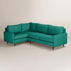 Handcrafted with soft woven upholstery, our custom-made sectional sofa boasts clean lines, subtly flared arms, piping detail and tapered cone legs in a rich walnut finish. This affordable, right-facing seat features sinuous springs for added comfort and reversible soybean foam cushions.