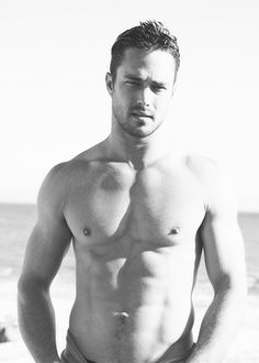 Taylor Kinney from Chicago Fire! Super hot!!!  Same CANNOT be said for his girlfriend!!!!!  WTF?!?!?