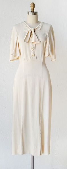Ivory silk dress cape sleeves and sailor bow, 1930's~Image via Adored Vintage