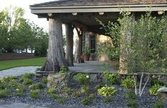 gorgeous porch area using trees; note landscaping by porch and in the distant background....  Adirondack Style Boathouse