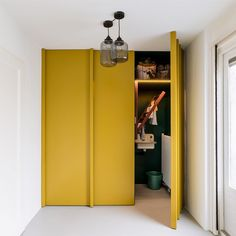 Home decoration is one of the most important elements that help you to define the… Hidden Laundry Rooms, Chandelier In Living Room, Interior, Home, Mustard Yellow Walls, Hidden Laundry, House Interior, Modern Chandelier Foyer, Yellow Cupboards