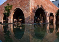 Wangstudio   F Coffee; cafe in Vietnam, brick arches, reflective pool