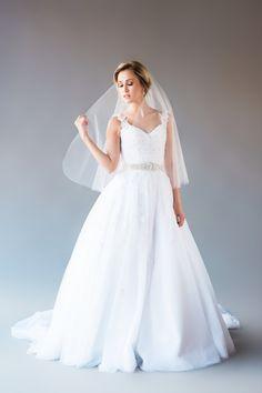 TIFFANY VEIL DESCRIPTION: single tier elbow length veil Veil is made of soft bridal illusion tulle and has a raw cut rounded bottom edge. Veil