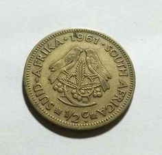 The 1st coin minted in SA after the Pound.