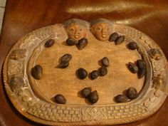 Ifa tray and palm nuts: while studying African art history, students learn that in most cultures who stay close to the earth, art, spirituality, and daily activities are too closen woven to separate