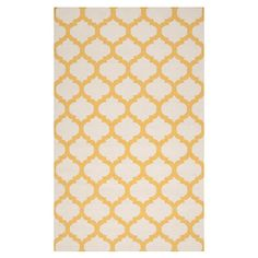 Hand-woven flatweave wool rug with a quatrefoil motif.       Product: Rug    Construction Material: 100% Wool    ...
