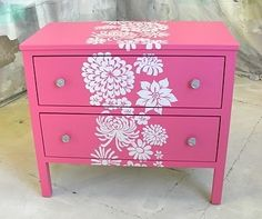 pink painted dresser with flower motif