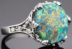 This Tiffany and Co black opal and diamond ring features an exceptional stone in a magnificently regal setting.