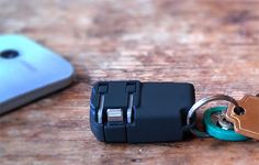 The Chargerito is the world's smallest phone charger; roughly the size of a car key fob. Offered with Apple Lightning connection or USB, it also features a built-in bottle opener. Gadgets And Gizmos, Electronics Gadgets, Tech Gadgets, Latest Phones, New Phones, Cool Technology, Technology Gadgets, Edc, Gift Guide For Men