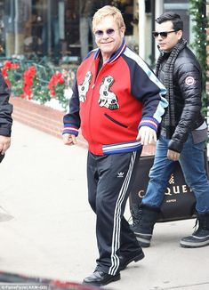 That's one pricey jacket: Sir Elton John left the Burberry store in Aspen on Wednesday wea...
